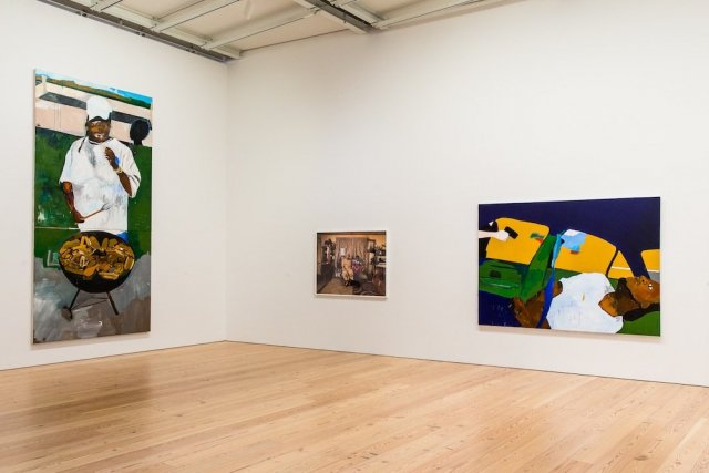 Installation view of Henry Taylor, The 4th, 2012-2017 and THE TIMES THAY AINT A CHANGING, FAST ENOUGH!, 2017. Collection of the artist; courtesy Blum & Poe, Los Angeles/New York/Tokyo. Whitney Biennial 2017, Whitney Museum of American Art, New York, March 17-June 11, 2017. Photograph by Matthew Carasella.  Installation view of Deana Lawson, Ring Bearer, 2016. Collection of the artist; courtesy Rhona Hoffman Gallery, Chicago, and Sikkema Jenkins & Co., New York. Whitney Biennial 2017, Whitney Museum of American Art, New York, March 17-June 11, 2017. Photograph by Matthew Carasella.