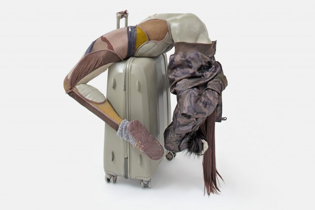 Anna Uddenberg, Savage #3 (camo cozy sock), 2017, aquaresin on fiberglass, suitcase, acrylic nails, synthetic hair, quilted faux leather, puffed jacket, faux fur, mesh, crystals, rubber slippers, cozy sock, camouflage tights 9 x 100 x 77 cm | 39 x 39 1/3 x 30 1/3 in unique. Courtesy the artist, Kraupa-Tuskany Zeidler, Berlin. Photo credit: Gunter Lepkowski.