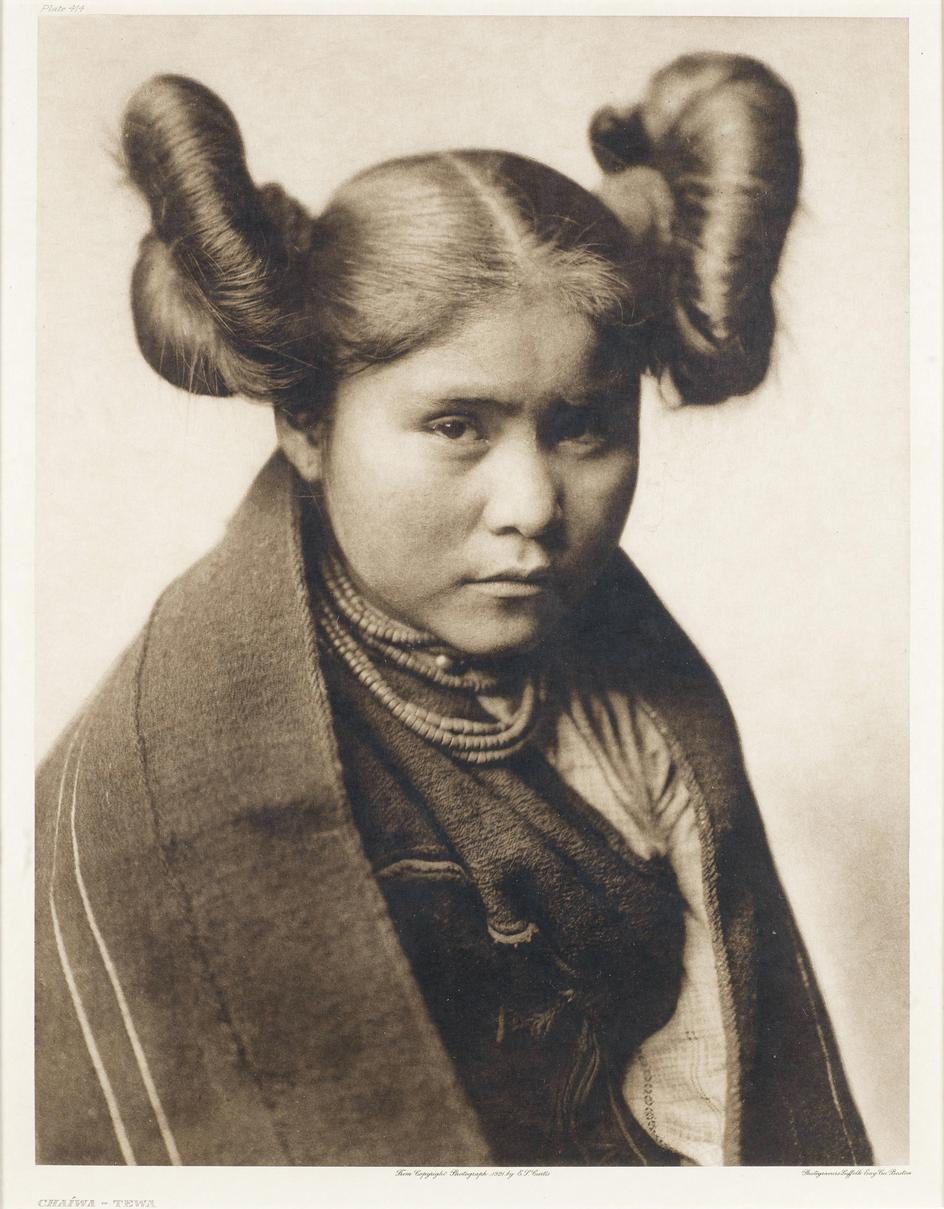 a native american woman with elaborate haircut