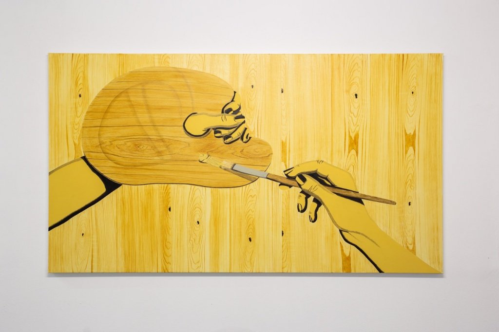 painting of a hand paining on fake wood
