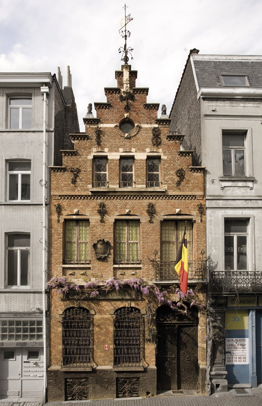 the facade of an old building in Brussels