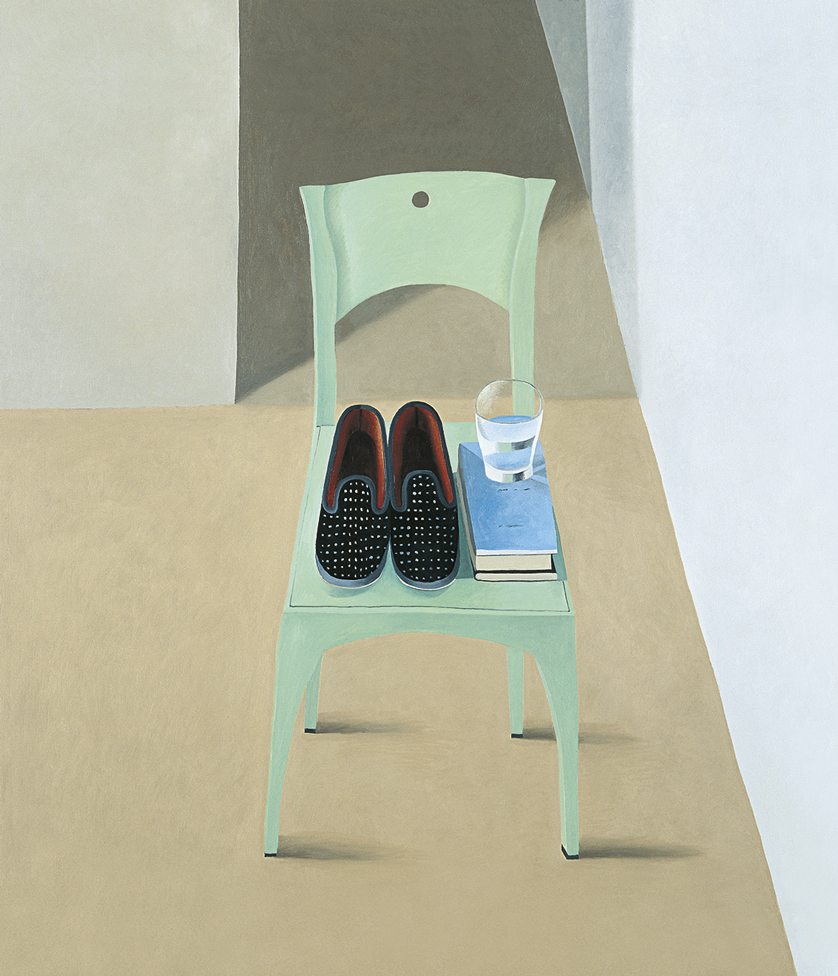 slippers with a glass and books on a chair