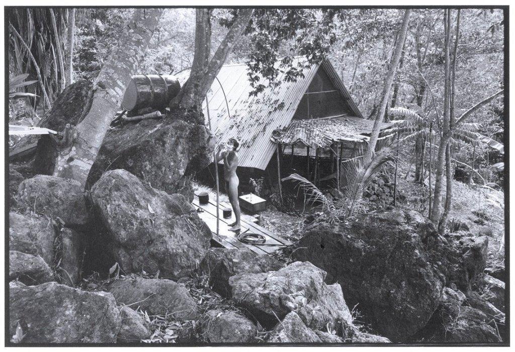 a man taking a bath in the jungle